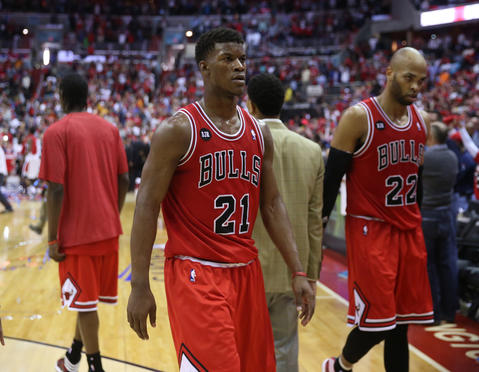 Jimmy Butler and Taj Gibson leave the court after the loss.