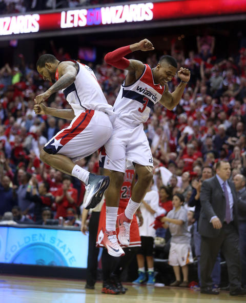 the Wizards' Trevor Ariza and Bradley Beal celebrate a late basket against the Bulls.