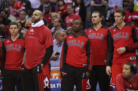 The Bulls bench watches the closing seconds of the Game 4 loss.