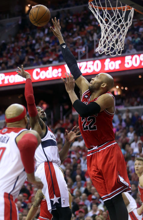 Taj Gibson defends against the Wizards' John Wall.