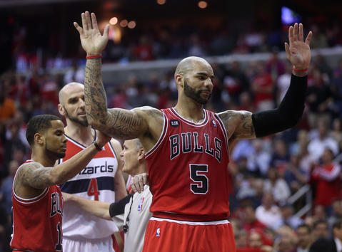 Carlos Boozer raises his hands against the Wizards.
