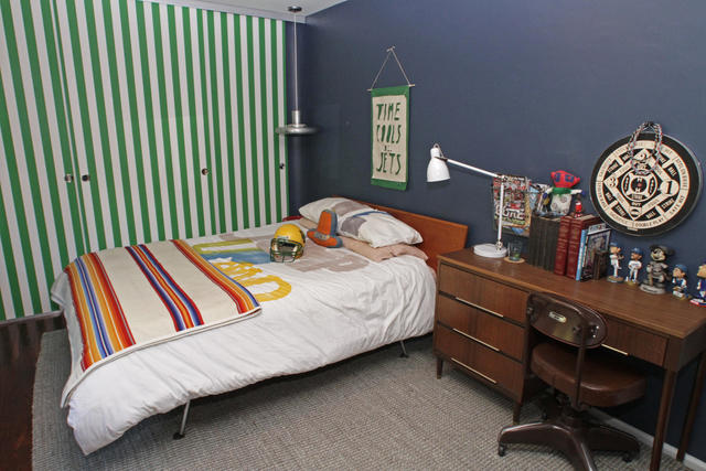 "In the Eagle Rock home of Mark and Melinda Fay, sturdy sliding barn doors for son Boon's room were covered with striped vinyl wallpaper by Marimekko. ""I wouldn't put anything fancy in my kid's room,"" Melinda Fay said. ""I wanted something that I can wipe down."""