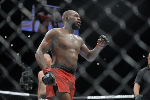 Jon Jones (red trunks) reacts after battling Glover Teixeira for the light heavyweight championship at UFC 172.