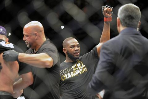 Jon Jones reacts after fighting Glover Teixeira for the light heavyweight championship at UFC 172.
