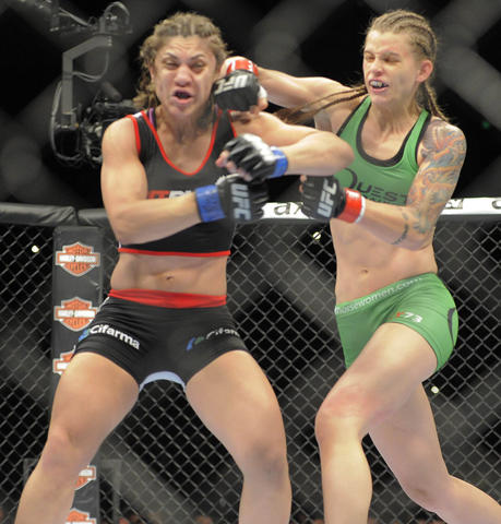 Jessamyn Duke punches Bethe Correia during their women's bantamweight bout.