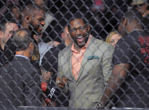 Jon Jones (left) talks with Ray Lewis after winning his fight.