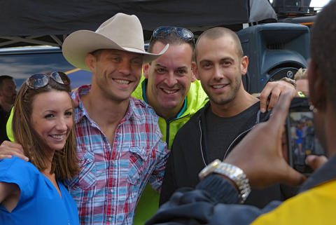 "Fans pose with fighter Donald ""Cowboy"" Cerrone outside the arena."