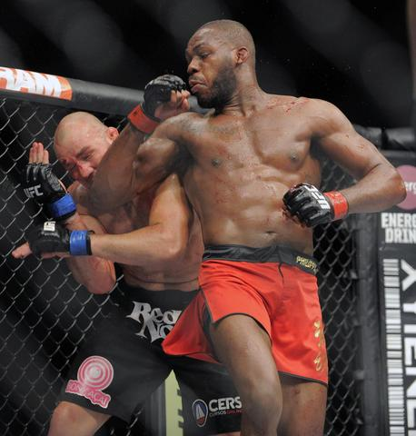 Jon Jones lands an elbow on Glover Teixeira.