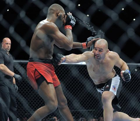 Jon Jones defends against a punch from Glover Teixeira.