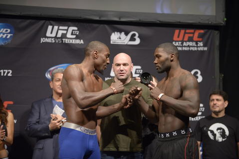 At UFC 172, Phil Davis (left) and Anthony Johnson (right) face off in front of UFC president Dana White during a weigh-in for their UFC light heavyweight fight at the Baltimore Arena.