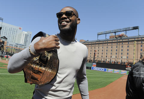 Jon Jones walks around Camden Yards with his UFC light-heavyweight belt.