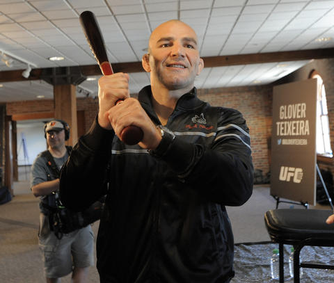 Glover Teixeira fools around with a baseball bat inside the Warehouse at Camden Yards.