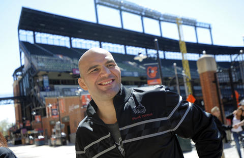 Glover Teixeira walks around Camden Yards.