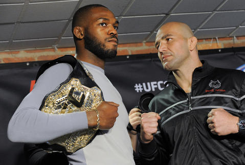 Jon Jones and Glover Teixeira pose for a picture inside the Camden Yards Warehouse.