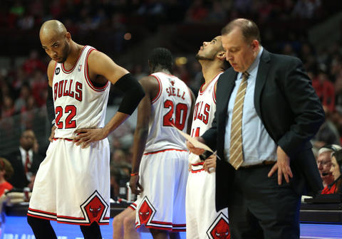 Taj Gibson and the rest of the team react during a timeout in the first half.