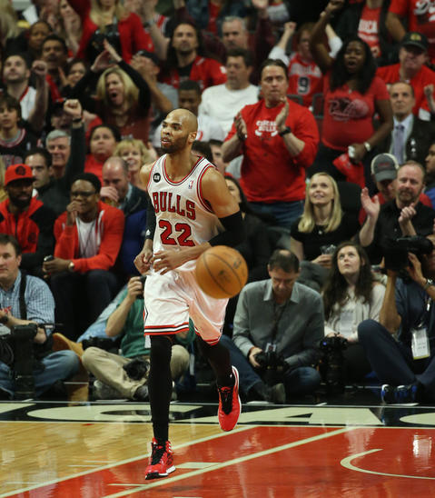 Taj Gibson heads down court after dunking the ball in the second quarter.