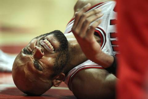 Taj Gibson winces in pain after suffering an injury in the second half.