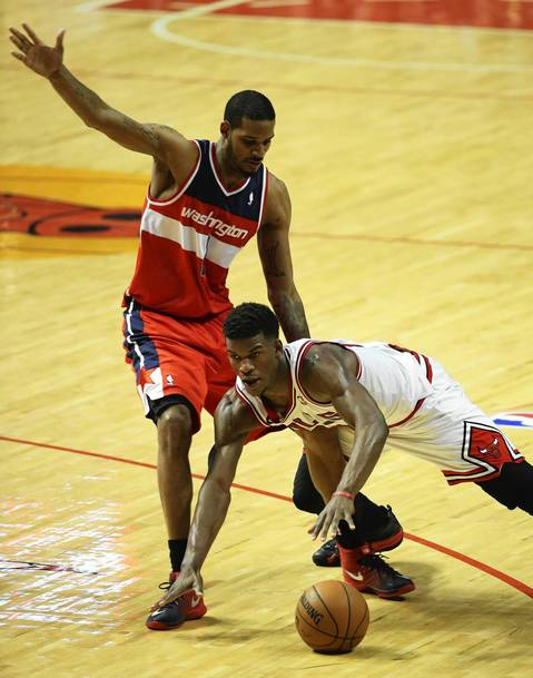 Jimmy Butler falls to the floor as the Wizards' Trevor Ariza defends in the fourth quarter.