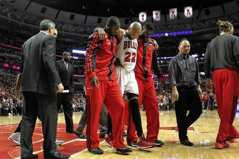 Taj Gibson is helped off the floor after suffering an injury in the second half.