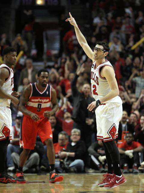 Kirk Hinrich celebrates after hitting a three-pointer in the second half.