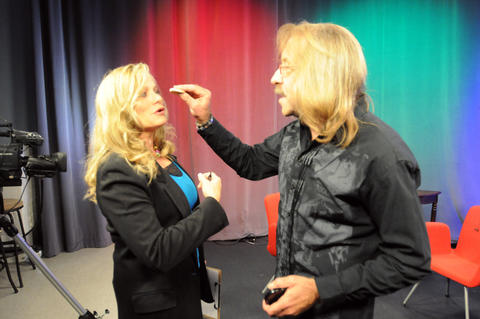 "Marsha Karp, producer of ""Cameras Rolling,"" being made up by guest Reno Venturi, owner Of Actors Gym and producer of ""Pleading Sanity."""