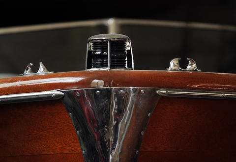 The bow of a 22' Chris Craft Sportsman shows the rich grain and chrome on brass hardware of this classic.