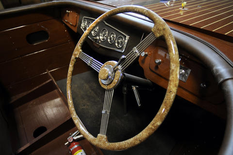 The cockpit of a 27' 1937 Chris Craft triple cockpit custom runabout  undergoing a complete restoration.