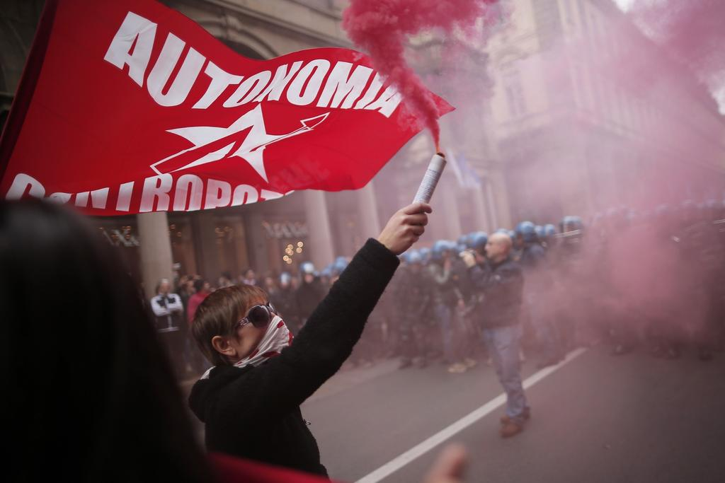 Anti-riot policemen face demonstrators in Turin during one of several rallies against unemployment and austerity in Italy for May Day, on May 1, 2014.