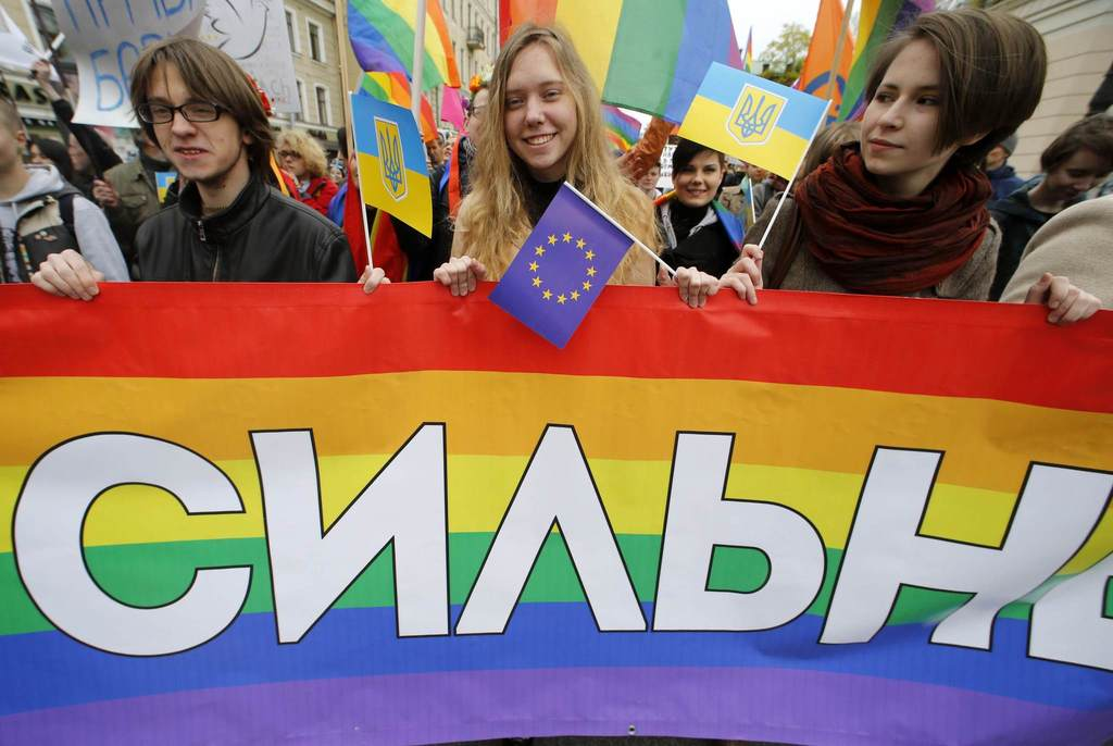 Gay rights activists march with a banner during a May Day rally in St. Petersburg May 1, 2014.