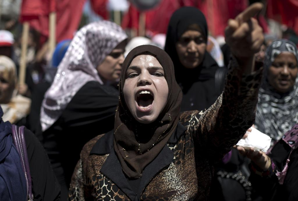 A Palestinian woman chants slogans during a May Day rally, on May 1, 2014 in Gaza City.