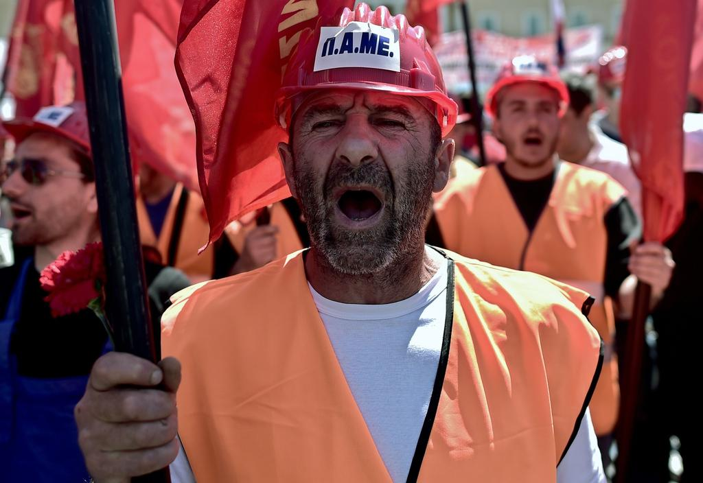 A Greek protester shouts slogans during a demonstration marking May Day in Athens on May 1, 2014.