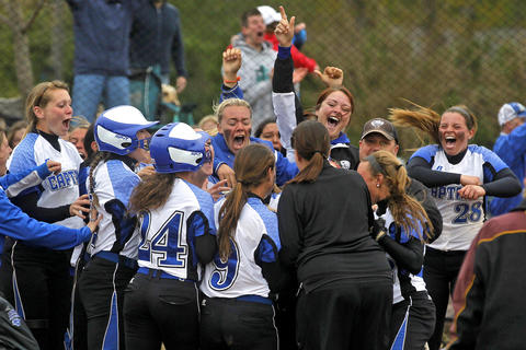 Staff Photo Of The Week: April 19-April 25, 2014    Christopher Newport University players celebrate and swarm Taylor Dillow after she hit a walk off two run to defeat Salisbury during Saturday's Capital Athletic Conference tournament at Captains Park.