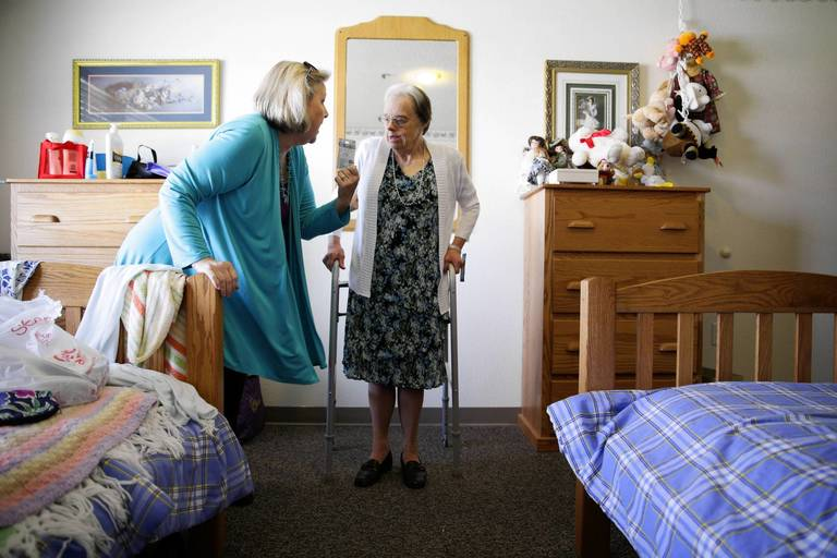 Monica Laskey, Right, Stands In Her New Room At Ridge Terrace, A Small
