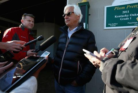 Trainer Bob Baffert talks to reporters.