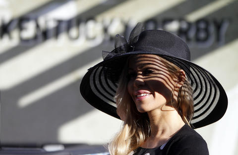 Tara Juergens wears a traditional derby hat.