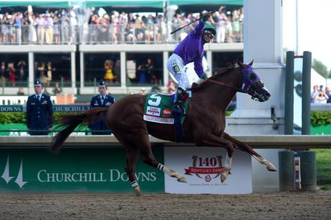 California Chrome, ridden by Victor Espinoza, crosses the finish line to win the 140th running of the Kentucky Derby at Churchill Downs on May 3, 2014.