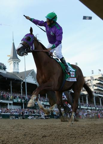 LOUISVILLE, KY - MAY 03: Jockey Victor Espinoza celebrates atop of California Chrome #5 after crossing the finish line to win the 140th running of the Kentucky Derby at Churchill Downs on May 3, 2014 in Louisville, Kentucky. (Photo by Matthew Stockman/Getty Images) ORG XMIT: 459248047