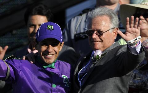 Victor Espinoza and trainer Art Sherman in the winner's circle after their horse California Chrome wins the 2014 Kentucky Derby at Churchill Downs.