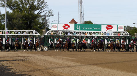 The gate opens at the start of the 2014 Kentucky Derby.