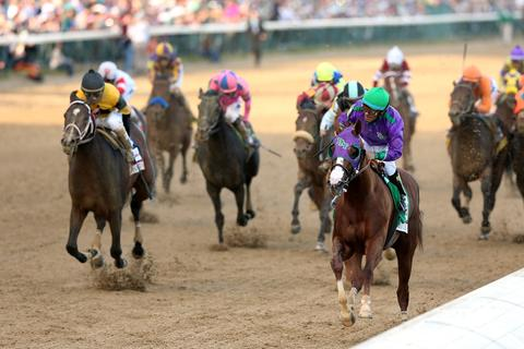 LOUISVILLE, KY - MAY 03:  California Chrome #5, ridden by Victor Espinoza, comes to the finish line to win the 140th running of the Kentucky Derby at Churchill Downs on May 3, 2014 in Louisville, Kentucky.  (Photo by Matthew Stockman/Getty Images) ORG XMIT: 459248047