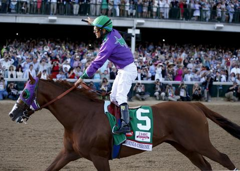 California Chrome, right and jockey Victor Espinoza ride to victory in the 140th running of the Kentucky Derby at Churchill Downs in Louisville, Ky., Saturday, Saturday, May 3, 2014. (Mark Cornelison/Lexington Herald-Leader/MCT)