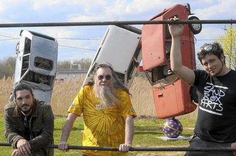 Peter Albano, on the left, and Joseph McCarthy, on the right, were given permission by Bill Ziegler, center, to use three old Yugos to make a sculpture on his property in Middletown, on Route 3 south of Route 372. It's going to be there permanently. Read story here.