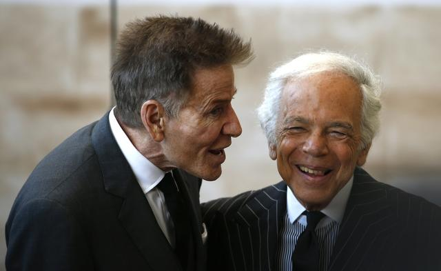 Fashion designers Calvin Klein (L) and Ralph Lauren greet each other as they attend a ceremony to open the Anna Wintour Costume Center at the Costume Institute at the Metropolitan Museum of Art.