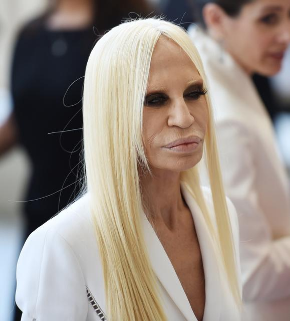 Italian fashion designer Donatella Versace attends the official opening of the Costume Institutes new Anna Wintour Costume Center.