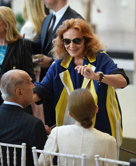 Fashion designers Diane von Furstenberg (C) and Oscar de la Renta (L, seated) at the official opening of The Costume Institute's new Anna Wintour Costume Center.