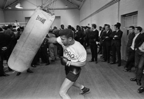 Ex-boxing champion Jimmy Ellis, seen here in 1966, died on May 7, 2014, at the age of 74. He was a onetime sparring partner for Muhammad Ali.