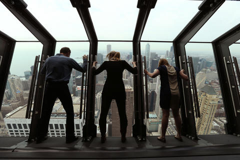 "Chicago Tribune reporter Steve Johnson (left) and Marketing managers Leslie Cooke (center) and Laura Collins (right) of Isabelli Media Relations at the The John Hancock Observatory's new attraction called ""Tilt!"""