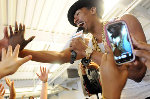 Nick Cannon, the MTV-generation actor and host of America's Got Talent  performed and posed in photos with students.