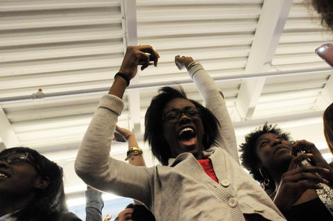 Students cheer as Cannon performs in the cafeteria.