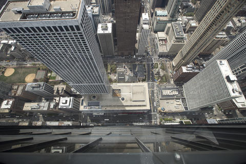 """The view from the new """"Tilt!"""" attraction on the 94th floor of the John Hancock Center in Chicago, Ill., on Thursday, May 8, 2014."""